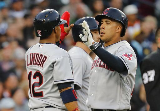 Cleveland Indians' Francisco Lindor (12) and Michael Brantley celebrate scoring on a Jose Ramirez triple against the Detroit Tigers during the fourth inning  in Detroit, Wednesday, May 3, 2017. (AP Photo/Paul Sancya) Indians won 3-2