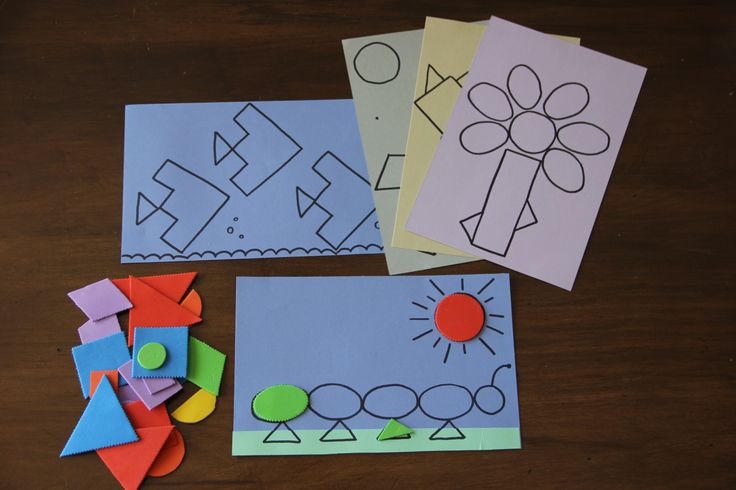Foam shape cuts outs placed on construction paper to make a larger picture/design.