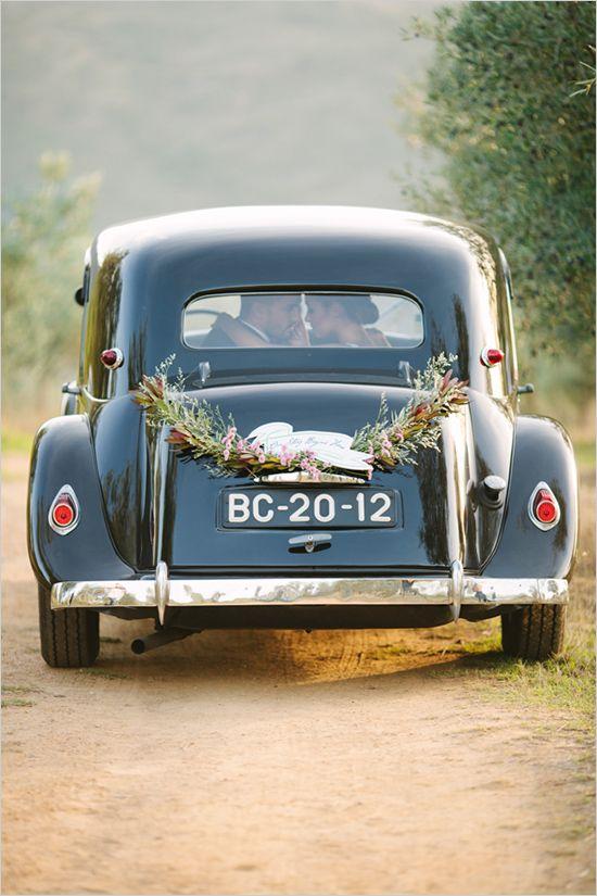 Vintage wedding getaway car.