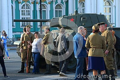 Soviet tank T-34 and people. Soviet medium tank. This tank was involved in World War II. Restored by search engines. Palace Square. Saint-Petersburg, Russia