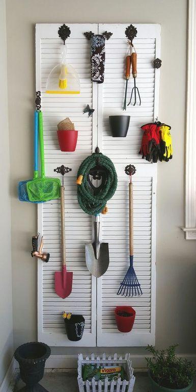 Organize your garage clutter on an old shuttered bi-fold door.