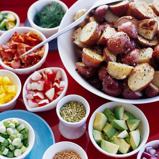 Surround a piled-high bowl of fresh potato salad with all the fixins' -- think bacon, avocado, radishes, chopped red onion, and mustard seeds.