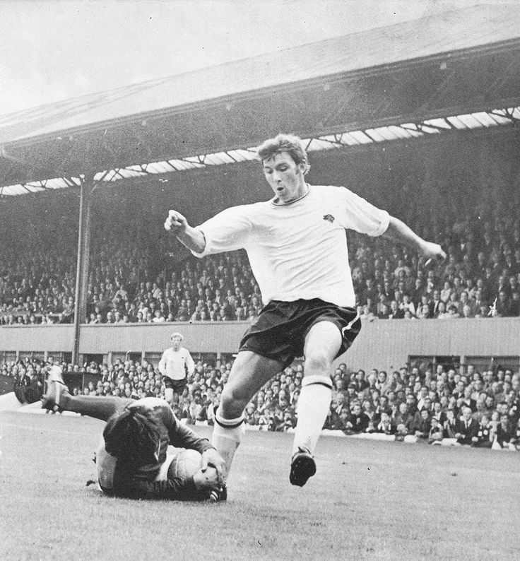 26th August 1970. Ipswich Town goalkeeper David Best diving at the feet of Derby County striker Kevin Hector, at the Baseball Ground