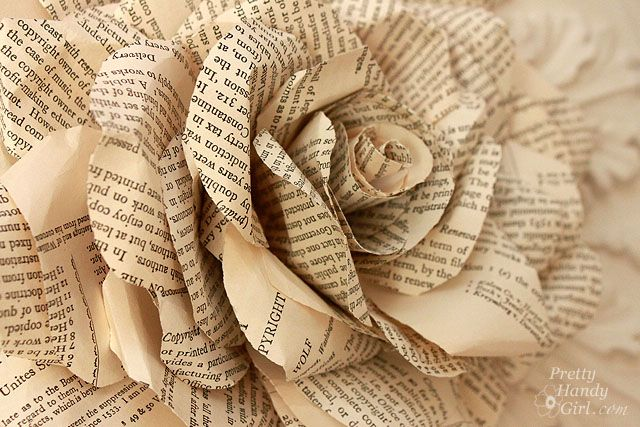 Flowers made of book pages  Book Pages to Paper Posies  All Things Fulfilling  Wedding ideas