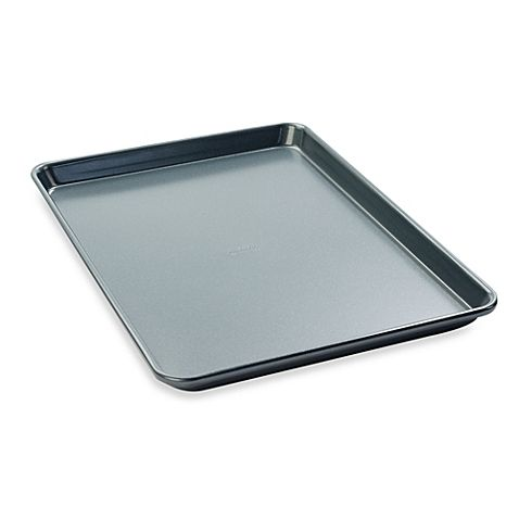 Bake cookies, jelly roll cakes, and all types of confections with this Chicago Metallic Professional Large Nonstick Cookie/Jelly Roll Pan. The thick rolled edges let you get a firm hold when inserting and removing the pan from the oven to avoid spills.
