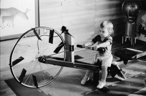 a little girl on an old-fashioned erg  -- TOO FUNNY!!  I Have This Exact SAME erg!!  a rowing matriarch Gave it to me... works beautifully... just no guages on it, but eyes closed, mind on the water... serves its purpose Wonderfully... and the plus... it fans you at the Same time....LOL