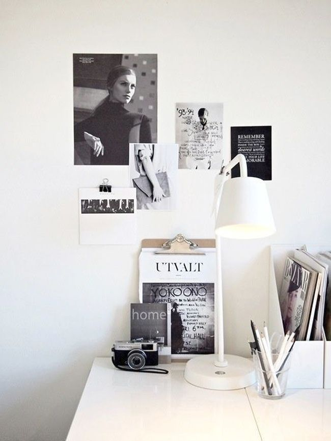 Stylish workdesk featuring black and white art and accessories.