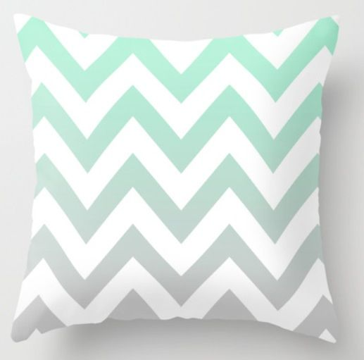 A throw pillow for the bed. White with mint green chevron, fading into grey.