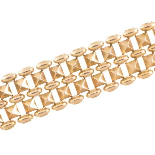 A fabulous wide retro gold bracelet. View our collection of antique, Art Deco, and modern jewellery at www.rutherford.com.au