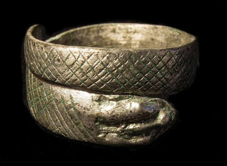 The silver ring. -- Roman Britain   http://www.atlasobscura.com/articles/snake-ring-roman-britain-a1-highway-construction