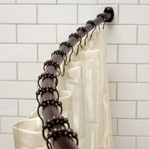 Curved shower curtain rod - fixed brackets.  Available in brushed nickel.