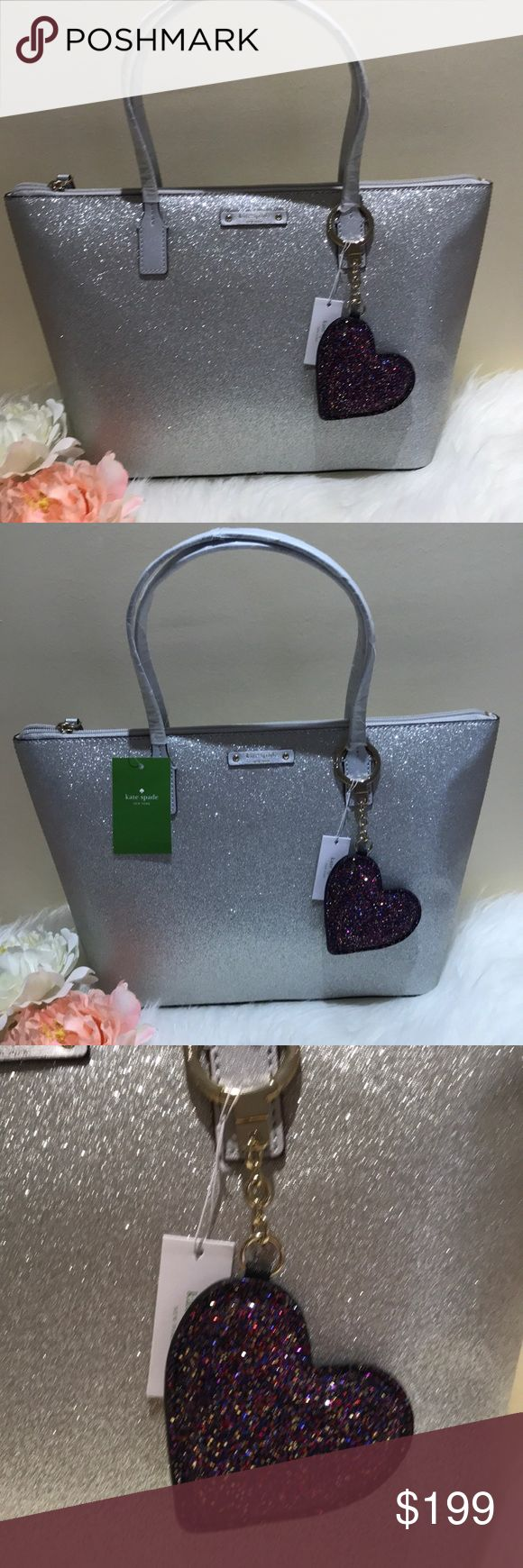 Kate Spade ♠️ silver holiday tote, bag charm nwt Stunning silver tote with zippered top and leather handles and bottom will turn heads for the holidays, comes with a matching sparkle bag charm which retails $69 plus tax alone. kate spade Bags Totes