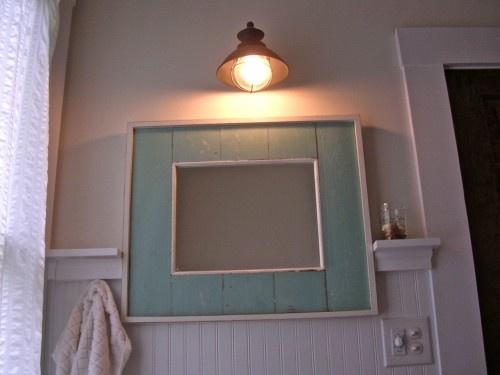 Reclaimed wood around the farmhouse bathroom mirror Robyn