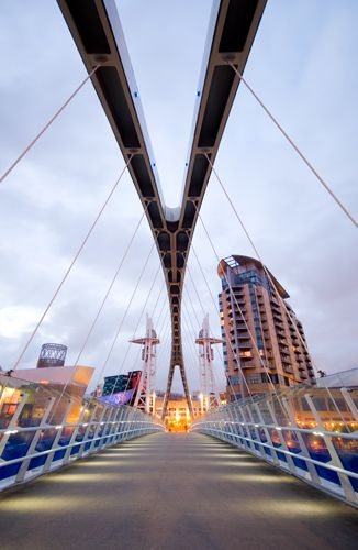 The Salford Quays Millenium Footbridge, Manchester Ship Canal in Salford, Manchester, UK by Carlos Fernandez Casado