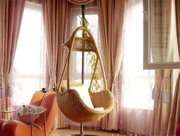 Indoor hanging chair – Hanging indoor rattan swing chair.  I think this could be nice on a screened in porch :)