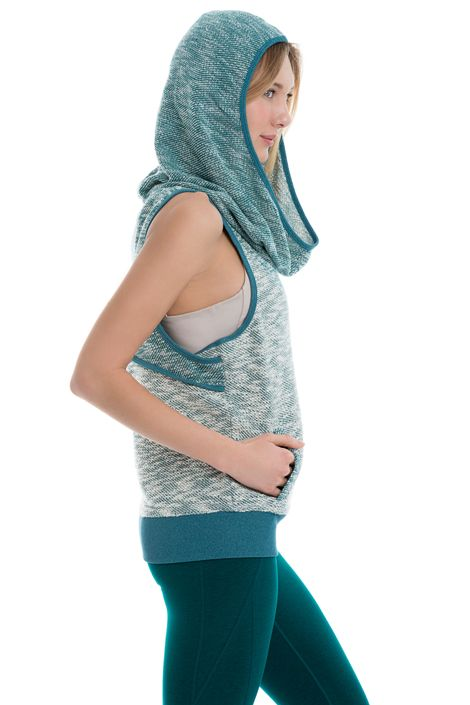This loose-fitting cover-up defines karma couture with its oversized hood, cut-out back and tweedy-look fabric. It's great for layering or lingering in Lolë's stretchy, textured Slub Terry. Loose fit &bull