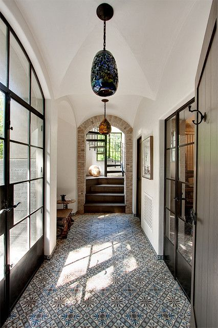 vaulted ceiling, tile floors, large steel-framed french doors
