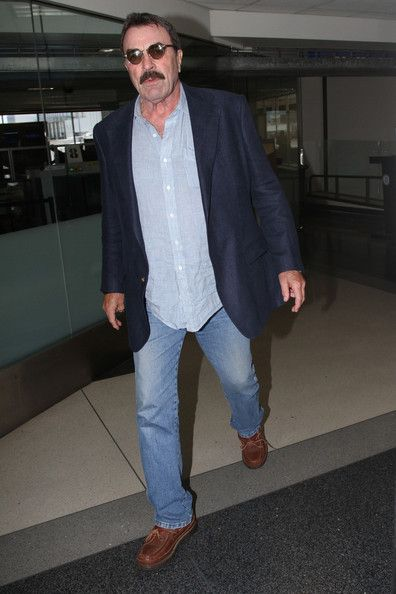 August 8, 2013. Tom Selleck makes his way through LAX.