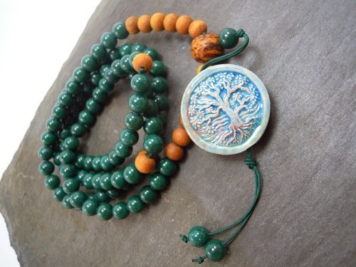 """8mm Mountain Jade and 8mm Sandalwood beads with a 10mm raw Bohdi seed guru and large Peruvian ceramic Tree of Life pendant.    This mala has incredible healing powers. (See below)  However, I designed this mala with the Vicenza Italy military yoga community in mind.  This was my first yoga home and I think of it often.  Collectively, this mala represents the Anahata Chakra. (Heart) In Sanskrit, the heart chakra is called Anahata, which means """"unstruck"""" or """"unhurt."""""""