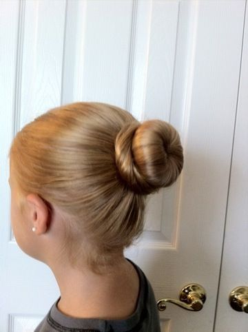 Easy Ballet Bun.  Used this method for Avery's recital today.  Held up the entire time.  Perfect!