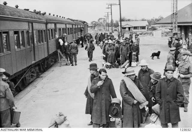Renmark, South Australia. 1943-05-13. Japanese internees starting to leave the train which brought them from Hay on their way to the Loveday Internment Camp Group in the Barmera area.