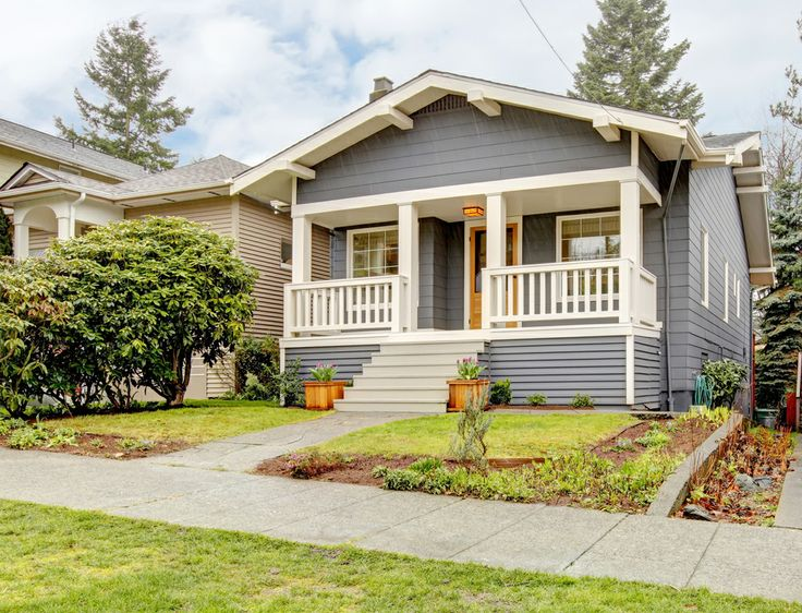 Grey craftsman style house with white porch. by via Dreamstime