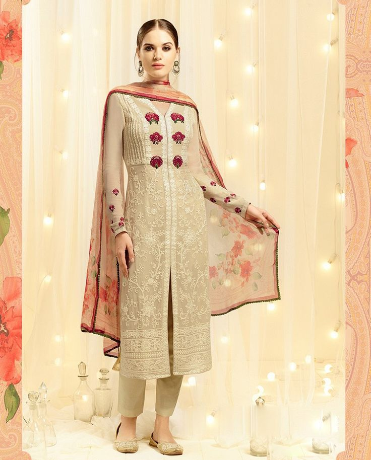Beige front slit suit with thread embroidery all over   1. Beige cotton silk straight suit2. Resham floral embroidery on hemline3. Comes with matching santoon bottom and chiffon dupatta3. Can be stitched upto size 42 inches