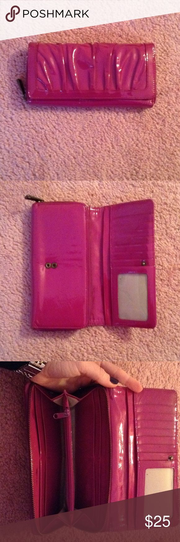 Magenta Nordstrom Wallet Magenta Nordstrom Wallet in good condition!! The wallet snaps open and has a zipper compartment. Plenty of space for your credit cards/ gifts cards etc. On the flap side there is clear slot for your license and two big slots for money, receipts etc. The zipper compartment opens up and has two sides including a section for change. Normal signs of wear, last picture shows a black stain, back side of wallet (not shown) has two little chips. Nordstrom Bags Wallets