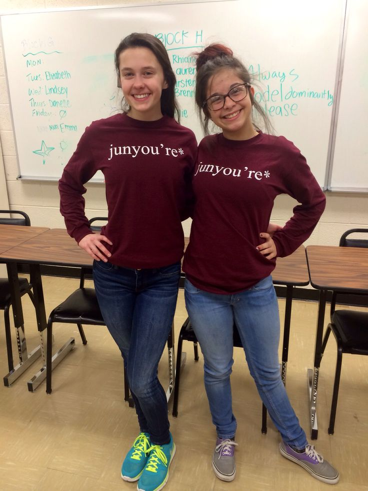 Juniors Morgan Stessman and Hannah Saalfeld pose for the camera and show off their Junior class T-shirts. The two were dressed for Junior seminar which then turned into Surprise Day!