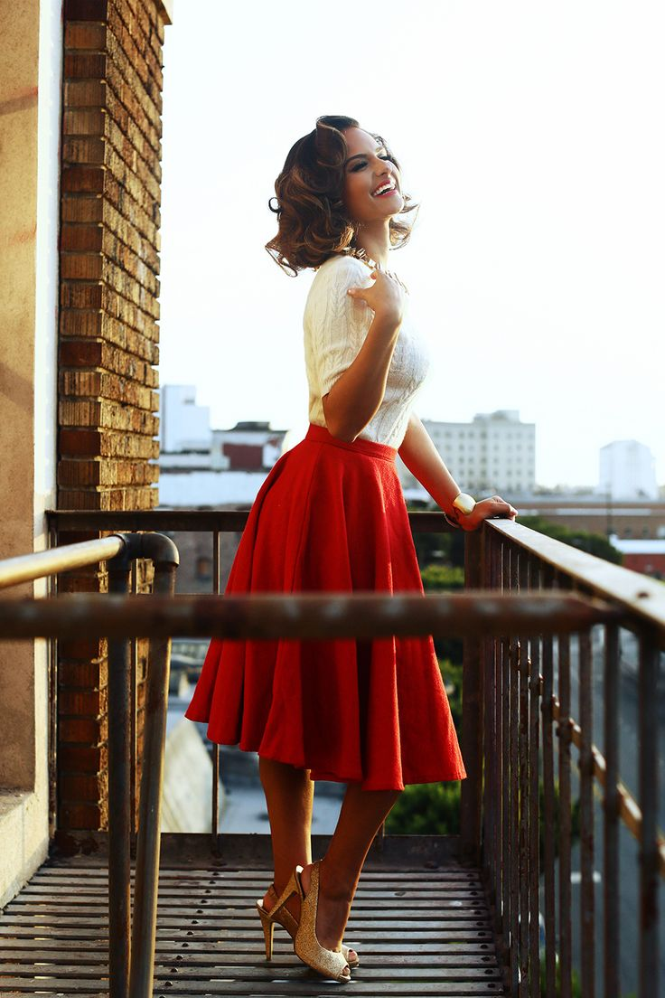 Red tea length skirt, preppy sweater, and sparkly gold heels. 50s inspred: