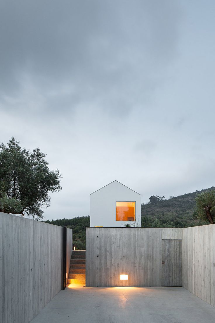 João Mendes Ribeiro slots concrete wine cellar below gabled house in rural Portugal