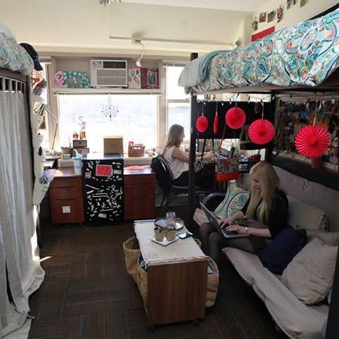 Desks are in the back corner, so you can loft the bed and put a futon or sofa underneath.