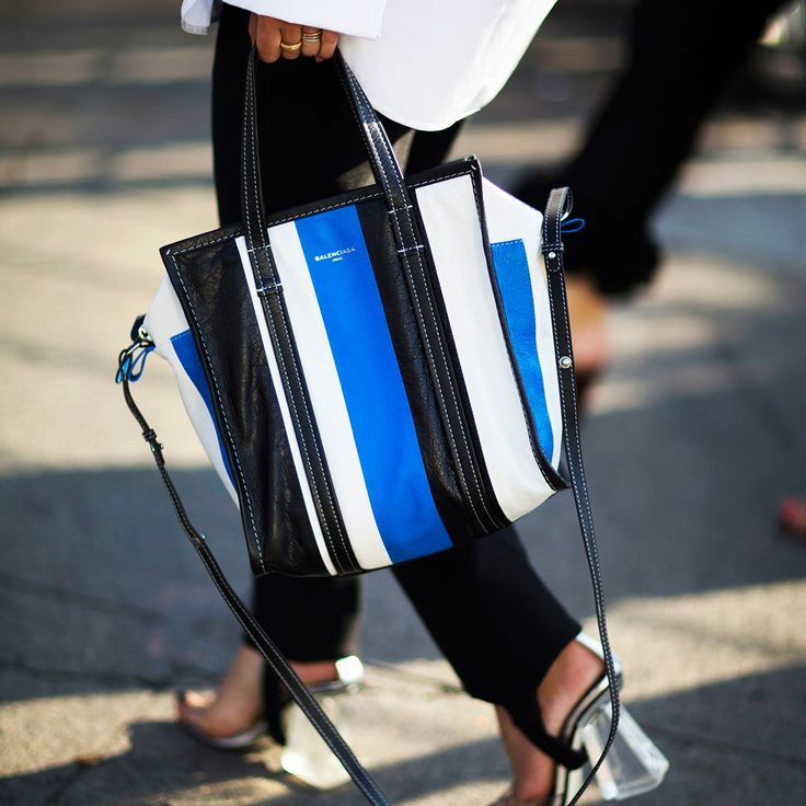 Balenciaga's Bazar bag draws on a vocabulary of references that are at once cerebral and witty, luxe and pedestrian. The result? Seriously cult appeal. http://www.matchesfashion.com/products/Balenciaga-Bazar-medium-grained-leather-tote-1064807#tab-2