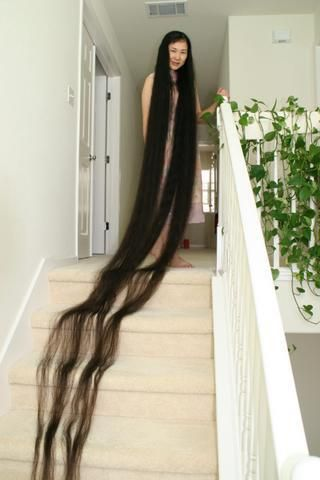 worlds longest hair ... Just how much money does she spend on shampoo every month??