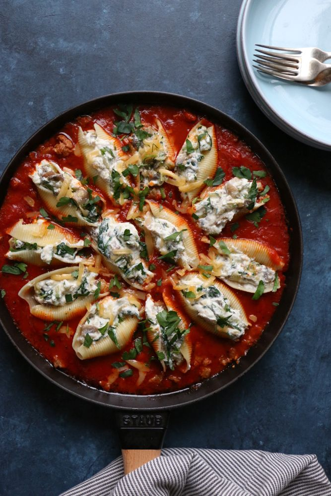Skillet Stuffed Shells with Zucchini and Mushrooms!! Stuffed shells filled with zucchini, mushrooms and ricotta cheese. This dish is so good! It's like deconstructed lasagna! The sauce has spicy Italian sausage and it is amazing. Skip the sausage if looking for a vegetarian meal!