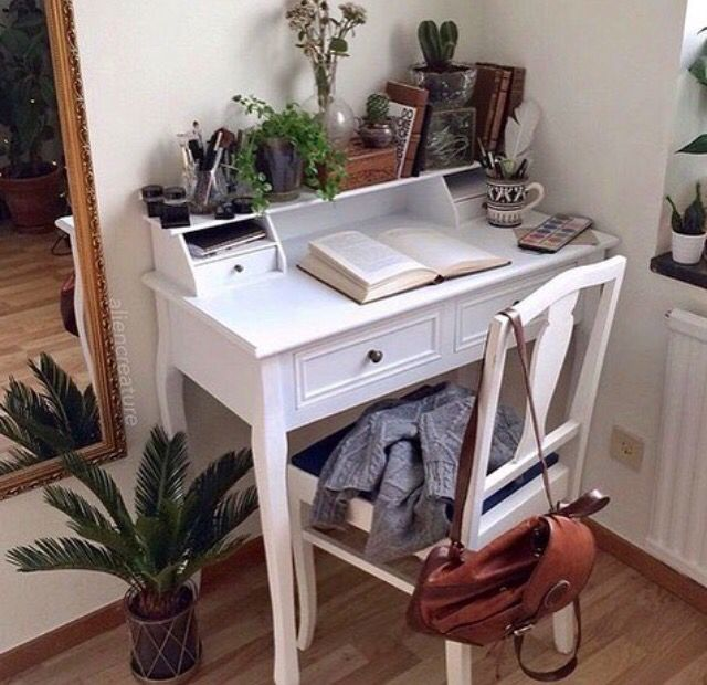 Small white desk, bright room, lots of plants. This is my dream!