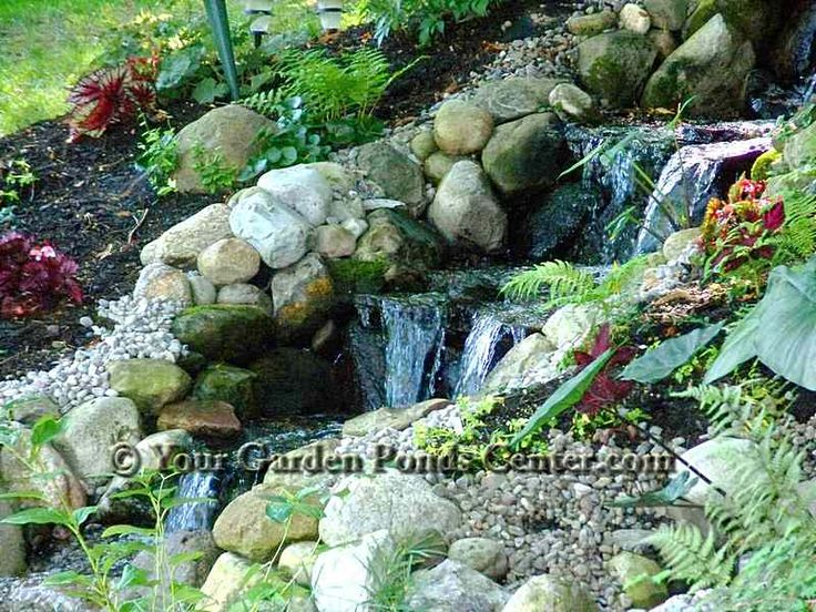 Waterfall pictures multi tiered waterfall down a slope for Build your own waterfall pond