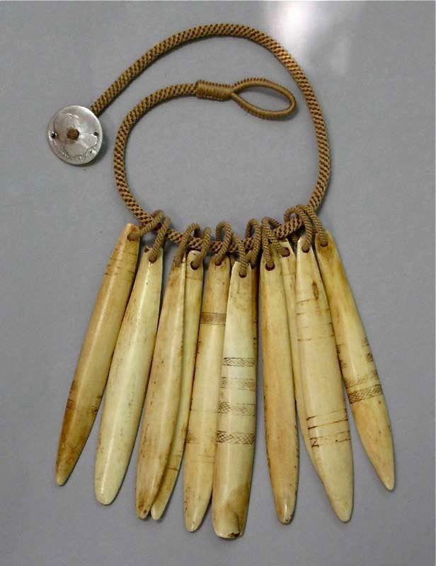 Shipibo, Peru, baby rattle pieces on hand woven cord   Design by Santa Fe Marrakech.