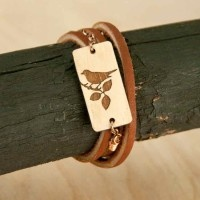 Brickbubble  Brickbubble Laser engraved, laser cut wood bird charm. All tied up with soft brown leather wrap bracelet.