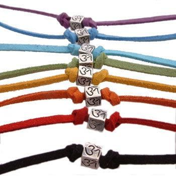 Small four-sided hand carved silver Om (Aum) cube on a color suede leather cord that can be tied as an anklet or bracelet. Pick your favorite color -- purple, blue, turquoise, green,... More Details