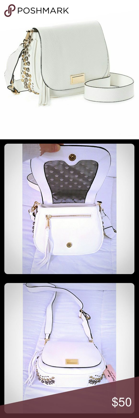 """NWT Juicy Coutur Sexy Crossbody/Clutch Saddle Bag New with tags gorgeous bright white Juicy Couture flap & snap closure Crossbody, Shoulder or clutch saddle bag. The long strap can adjust as short as you want to about 26"""" long. Or unhook & hold it like a clutch. Features gold emblem on the front, fringe zipper pull, back outside pocked, interior zip pocket & 2 pouches. And the studded gold & silver detail along the sides & bottom completes this beautiful bag. 10""""w 8"""" h 3"""" d NO TRADE. PRICEC…"""