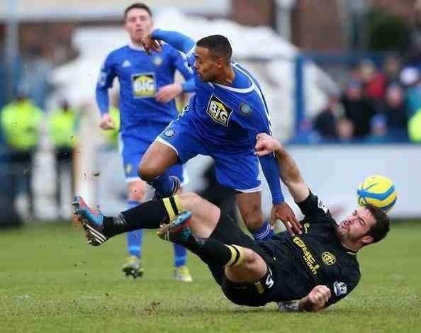 The 'Pink Iguana' Roman Golobart in action against Macclesfield Town