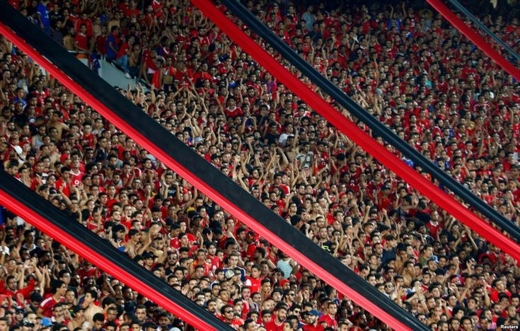 October 22, 2017:  Football fans cheer during the CAF Champions League semi-final football match between Al Ahly and Etoile du Sahel at the Borg El Arab Stadium in Alexandria, Egypt, Oct. 22, 2017.