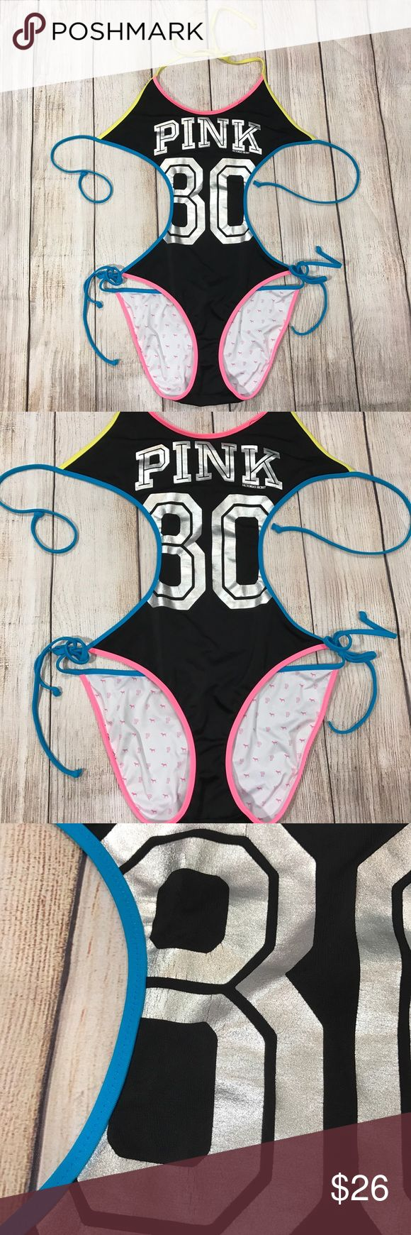 Victoria's Secret PINK 80 swim sexy one piece Victoria's Secret PINK swim one piece. Two tie strips at neck and at back of chest. Open sides. The number 8 is cracking a bit. Otherwise no stains or holes. Length from top of chest to bottom: 24 inches. Across chest:  16 inches. Across hips: 13 inches PINK Victoria's Secret Swim One Pieces