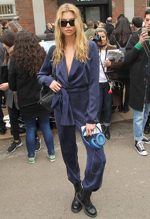 Stella Maxwell gave her jumpsuit a tailored overhaul via blazer lapels outside the Fendi show at Milan Fashion Week. Casually undone to the navel, Stella adds a black roll neck underneath. A waist-revealing tie adds to the smart factor, while the slinky fabric keeps jumpsuit obsessees in their comfort zone. Style with your fave DMs and you've got the ultimate outfit on your hands