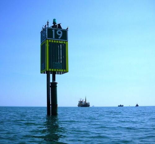 Channel Marker #19, off Rosebud - March, 2009. The dredge, The Queen of the Netherlands, is in the background. This was deepening the shipping channel in Port Phillip