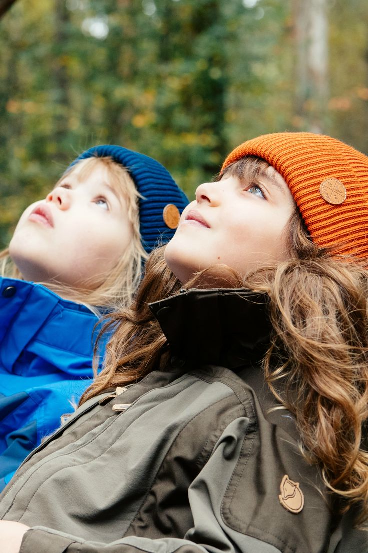 Kids outdoor outfit with blue and orange wool beanies for kids. Girls fall look for hiking. Hiking with kids.