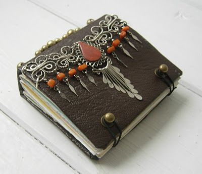Most of her journals are made from repurposed materials.  Jennibellie.