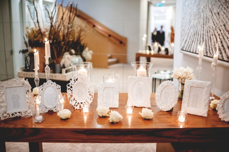 Wedding table plan in individual white frames | Photography by http://www.rossharvey.com/
