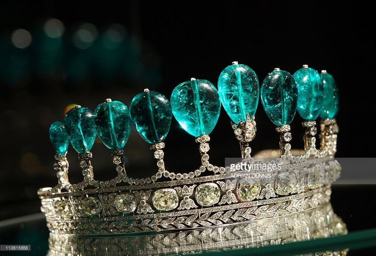 An emerald and diamond tiara is pictured on display at Sotheby's auction house in London, on May 4, 2011. The tiara composed of 11 Colombian pear-shaped emeralds and weighing over 500 carats, was created for Princess Katharina Henckel von Donnersmarck and is alleged to be the most valuable tiara to have appeared at auction for over 30 years. It is expected to sell between GBP 3.1-6.2m (dollars 5.1-10.2m or euros 3.5-7m) when it is auctioned at the Magnificent and Noble Jewels in Geneva on…